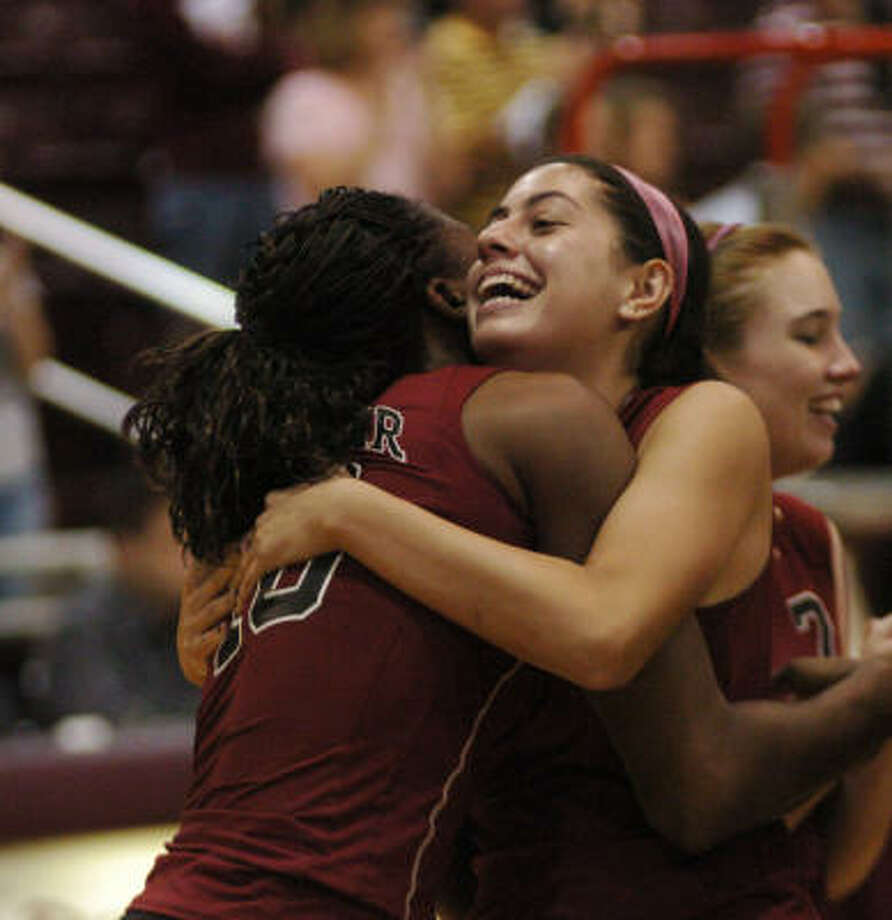 Nneka Ogwumike and Angelica Gomez share a hug as they celebrate their victory over Clear Creek in the Region III volleyball finals Saturday. Photo: Kirk Sides, For The Chronicle