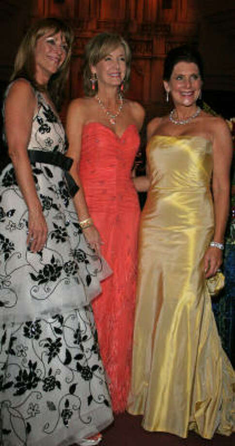 Franci Crane, from left, Sheridan Williams and Ellen Susman have the right idea when it comes to a black tie event. Photo: Gary Fountain, For The Chronicle