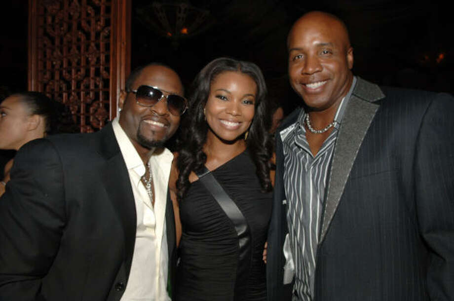 Like him or not, Giants outfielder Barry Bonds, right, has earned a place among stars like singer Johnny Gill and actrss Gabrielle Union. His pursuit of Hank Aaron's career home run record will be one of the year's biggest stories. Photo: Stephen Shugerman, Getty Images