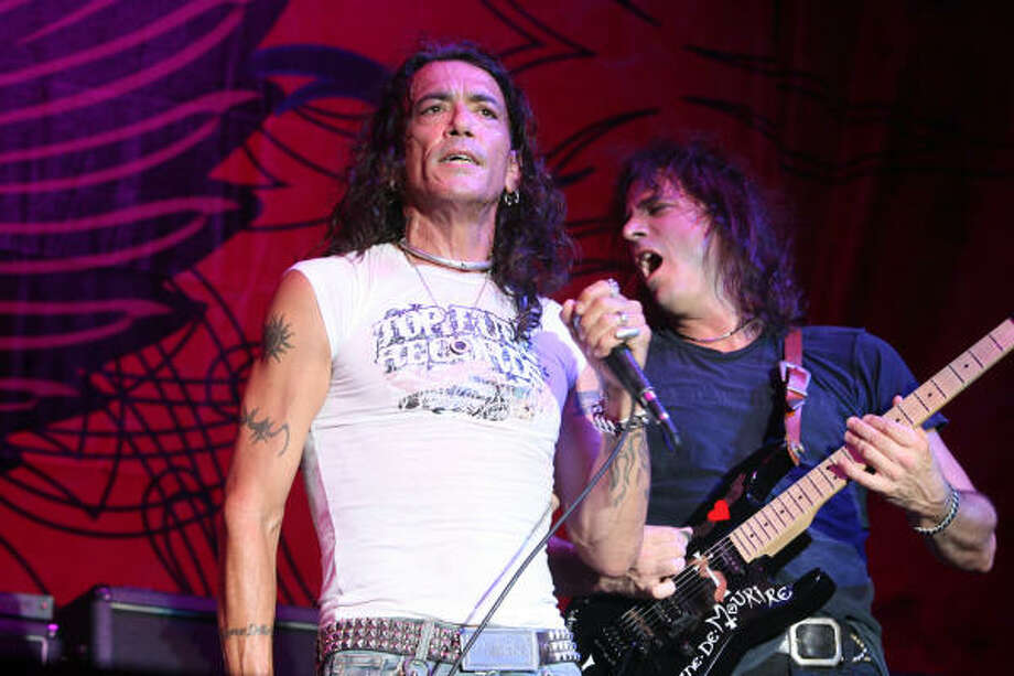 Stephen Pearcy, left, and Warren DeMartini of Ratt perform. Photo: Bill Olive, For The Chronicle
