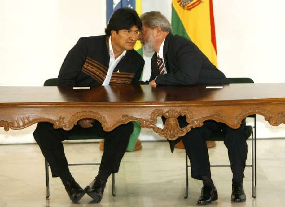Bolivia's Evo Morales, left, listens to Brazilian President Luiz Inacio Lula da Silva at the Presidential Palace in Brasilia on Thursday. An agreement between the two will mean that Brazilians will pay as much as 11 percent more for Bolivian natural gas. Photo: ANDRE PENNER, ASSOCIATED PRESS