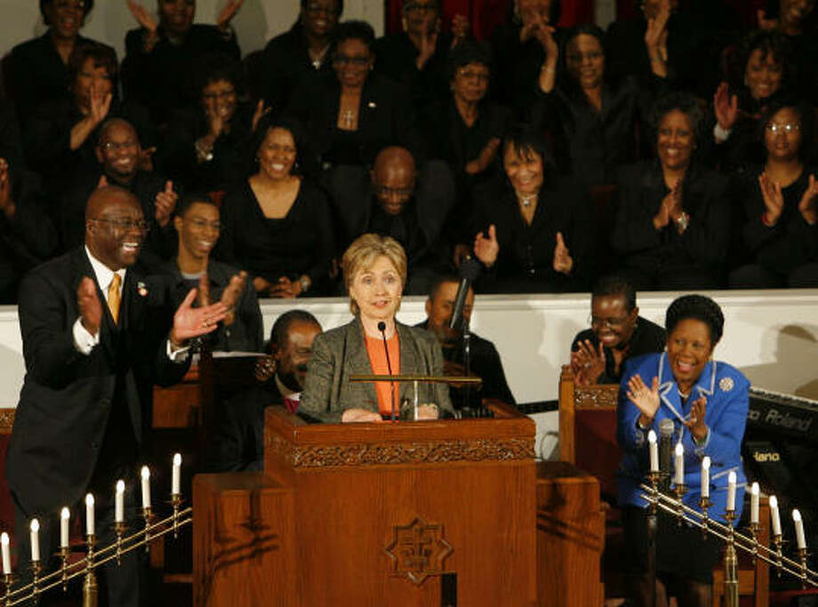 Senator and presidential hopeful Hillary Rodham Clinton receives applause as she speaks at the Wesley AME Church in downtown Houston today. Photo: Steve Campbell, Chronicle