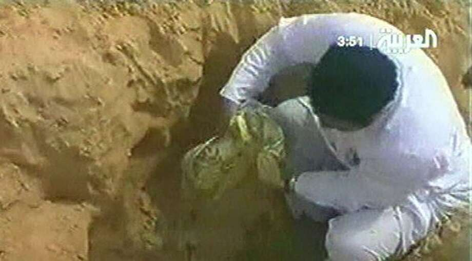 This broadcast image shows buried weapons in the desert. Saudi police arrested 172 suspects in a militant plot. Photo: AL-ARABIYA VIA ASSOCIATED PRESS