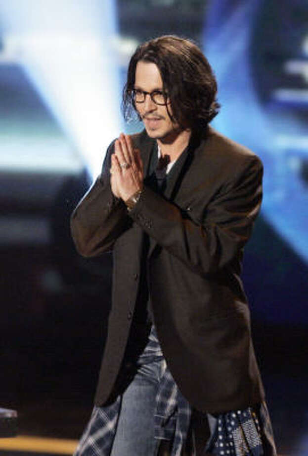 Actor Johnny Depp comes out on stage to accept the Best Movie award for Pirates of the Caribbean: Dead Man's Chest on Sunday during the MTV Movie Awards in Los Angeles. Photo: Mark J. Terrill, AP