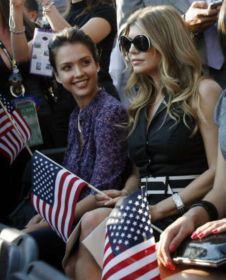 Singer Fergie, right, and actress Jessica Alba at Invesco Field on Aug. 28. Photo: Charles Dharapak, AP
