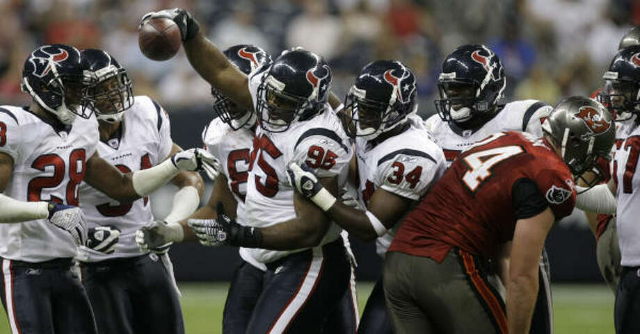 Texans defensive tackle Anthony Maddox holds a football aloft after intercepting a pass from Tampa Bay Buccaneers quarterback Chris Simms during the third quarter of Thursday night's preseason finale at Reliant Stadium. That was one of few bright spots for the Texans, who lost 16-6. Photo: Brett Coomer, Chronicle