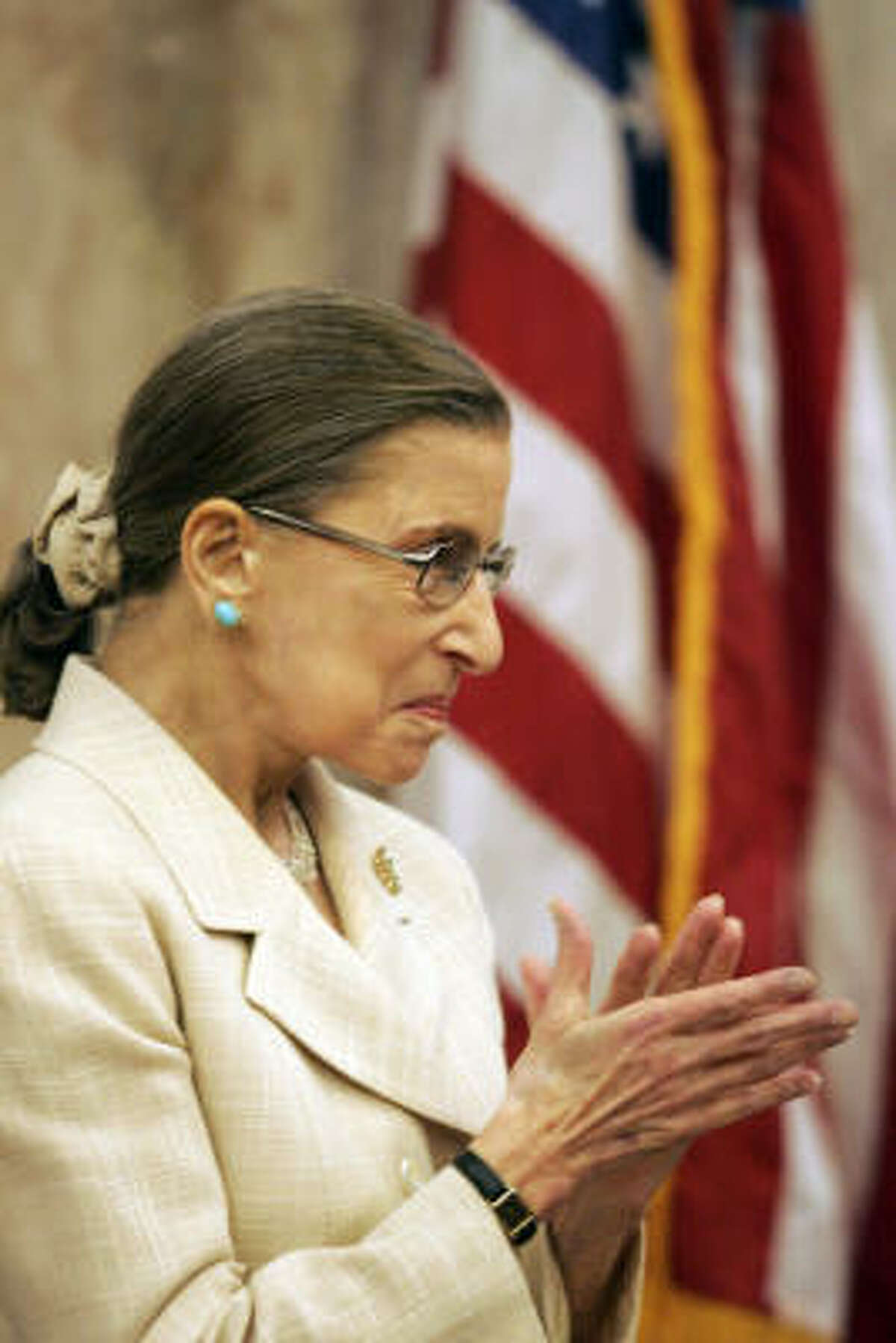 U.S. Supreme Court Justice Ruth Bader Ginsburg applauds as King receives the award.