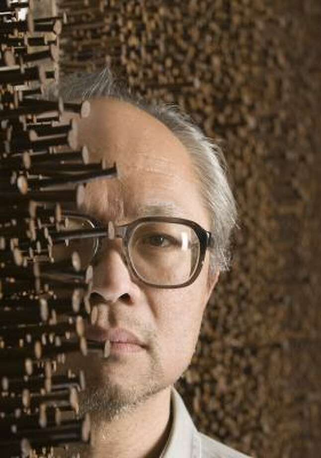Mel Chin poses with a part of one of his installations at The Station. Photo: Brett Coomer, Chronicle