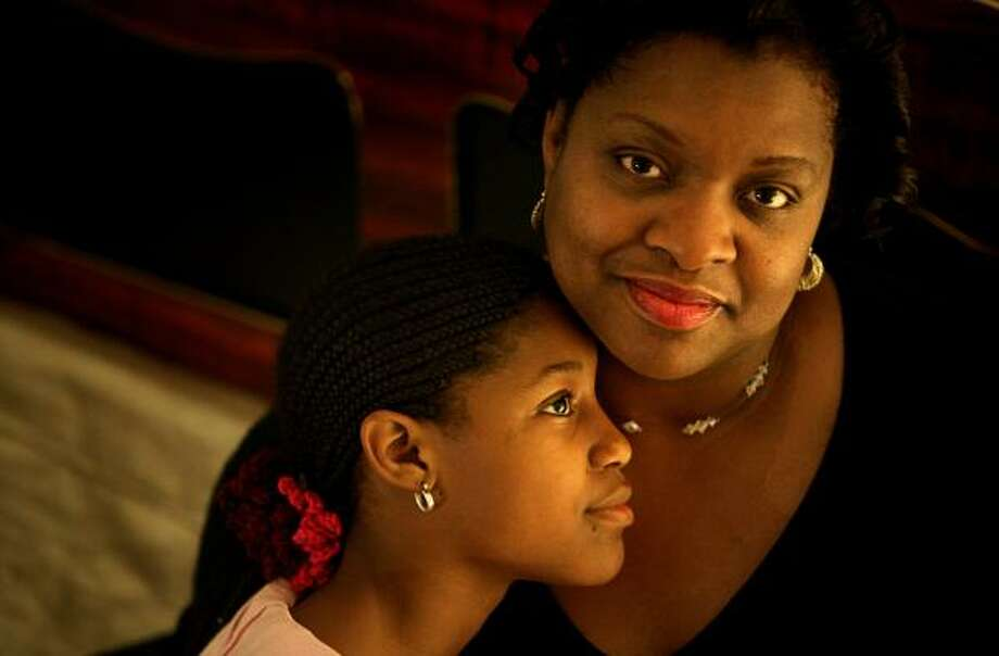 Catherine Turner and her daughter, Esosa Inuaghata, 11, rent and share a single room in a house in southwest Houston. Photo: ERIN TRIEB, FOR THE CHRONICLE