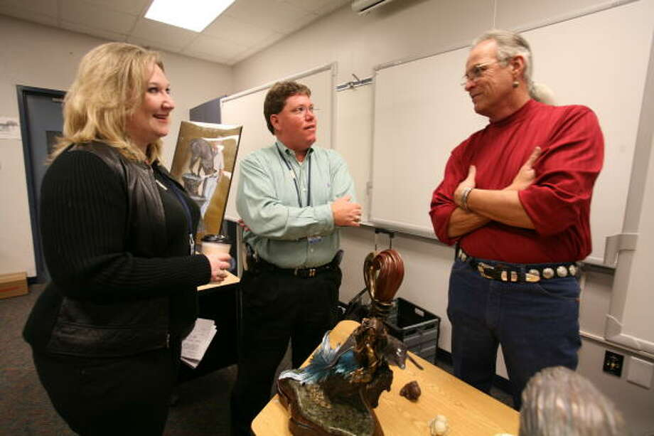 From left, Julie McCain, humanities teacher at Lamar Consolidated High School, Walt Beavers, Lamar principal and R. David Mattiza. Photo: Suzanne Rehak, For The Chronicle