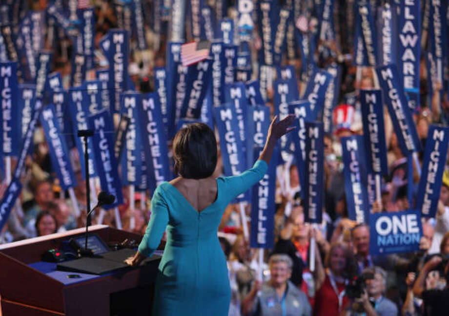 Michelle Obama waves to the crowd during day one of the Democratic National Convention in Denver. Photo: John Moore, Getty Images