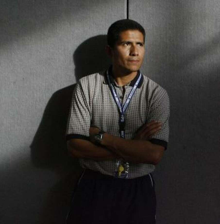 Teacher Elmer Villatoro used the defibrillator at DeBakey. Photo: Carlos Antonio Rios, Chronicle