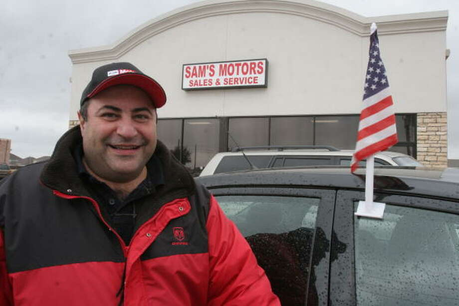 "Samar ""Sam"" Yacoub, 42, a Lebanese immigrant, is living the American dream having opened Sam's Motors at 3755 N. Fry Road in 2006. Photo: Suzanne Rehak, For The Chronicle"