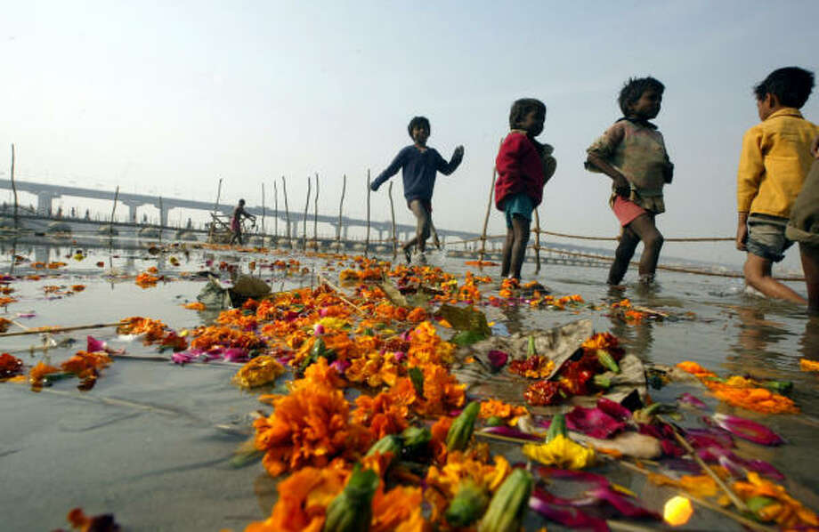Children search for coins offered by devotees in the polluted waters of the river Ganges in Allahabad, India, in January. Photo: Rajesh Kumar Singh, AP
