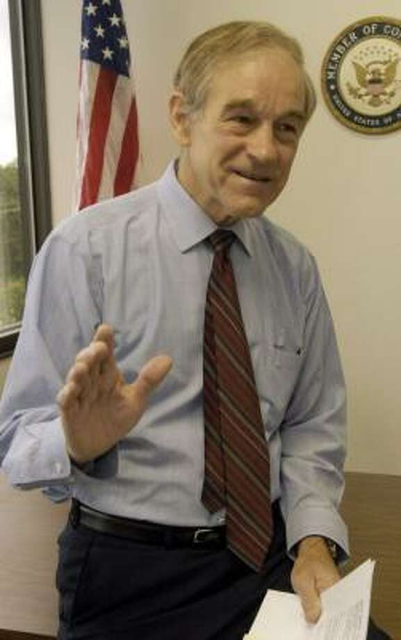 Rep. Ron Paul, shown in 2005 in his Lake Jackson office, plans to travel to several states before deciding whether to enter the presidential race. Photo: KIM CHRISTENSEN, FOR THE CHRONICLE