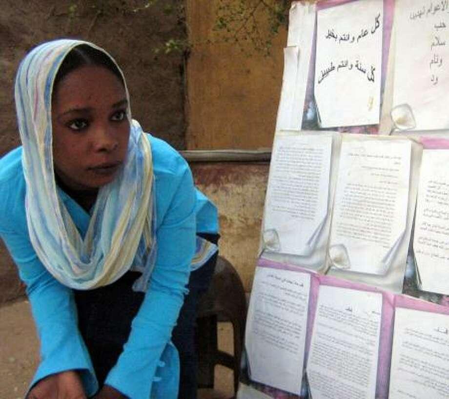 Awatif Ahmed Isshag posts her newspaper, Al Raheel, on a tree near her house in El Fasher, Sudan. Photo: STEPHANIE MCCRUMMEN, WASHINGTON POST