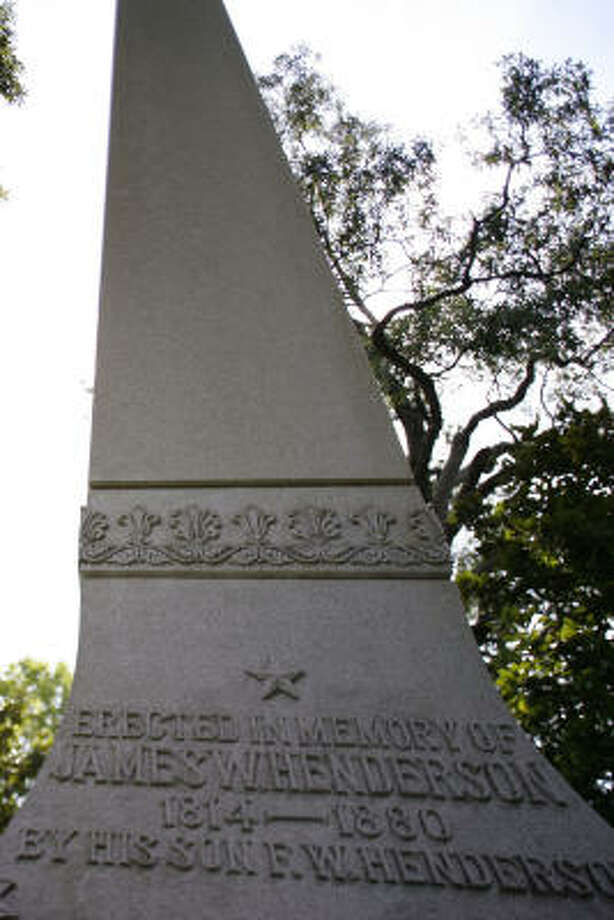 James W. Henderson may have the tallest gravestone in Houston. Photo: Sharon Steinmann, Chronicle
