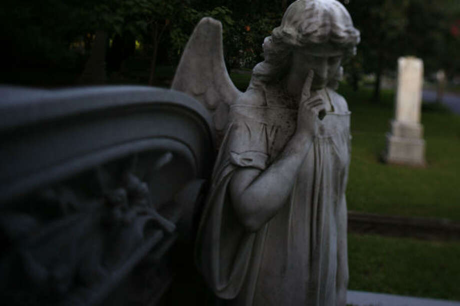 More than 90 angels, in all poses, grace Glenwood Cemetery. Photo: Sharon Steinmann, Chronicle