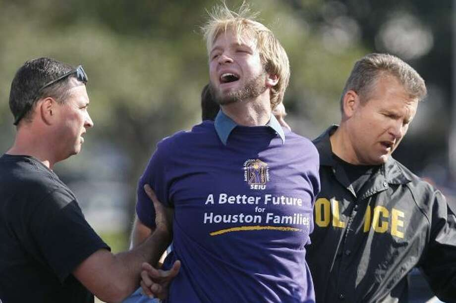 A protester is arrested during an SEIU demonstration that blocked traffic in the Galleria area in November. Some protesters received fines as high as $2,000 and seven-day jail sentences. Officials say they warned union leaders what to expect if they blocked roads. Photo: STEVE CAMPBELL, CHRONICLE FILE
