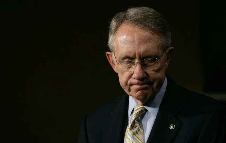 Majority Leader Harry Reid, D-Nev., leaves the Senate after passage of a timeline for Iraq withdrawal. Photo: CHARLES DHARAPAK, ASSOCIATED PRESS