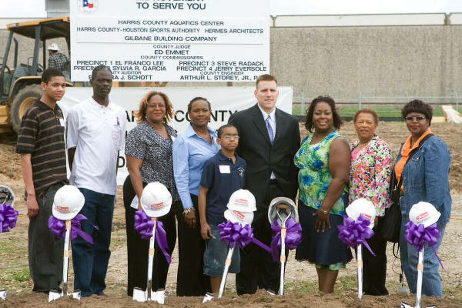 Karson Applin, left, Paul Rogers, Dorcine Foster, Rita Foster, Kaulen Applin, James Strickland, Stephanie Roqumore, Annie Douglas and Carolyn Pipkin participated in a groundbreaking ceremony for the new Harris County Aquatic Center. Photo: R. Clayton McKee, For The Chronicle