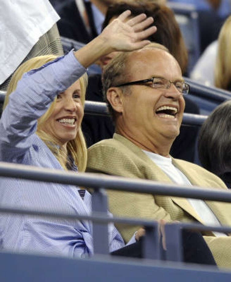 Actor Kelsey Grammer, right, and his wife, Camille, watch Andy Roddick take on Fabrice Santoro on Wednesday. Photo: Henny Ray Abrams, AP