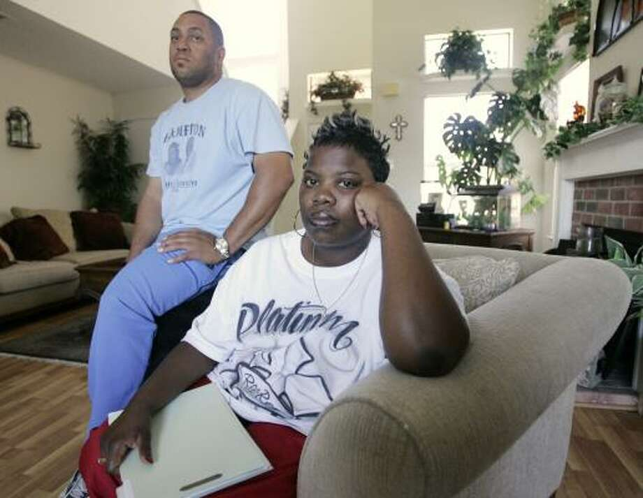 Tyrone Wynn, left, and his wife, Eylonda, relax in their new home in Cedar Hill, a Dallas suburb. They still get upset when reminded of how they lost their first home to foreclosure. Photo: TONY GUTIERREZ, ASSOCIATED PRESS