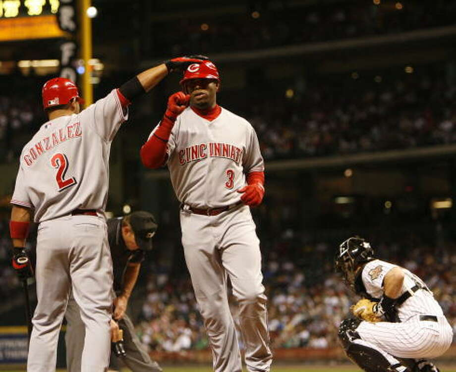 Cincinnati's Ken Griffey Jr. and Alex Gonzalez (2) had back-to-back homers in the third. Photo: Karen Warren, Chronicle