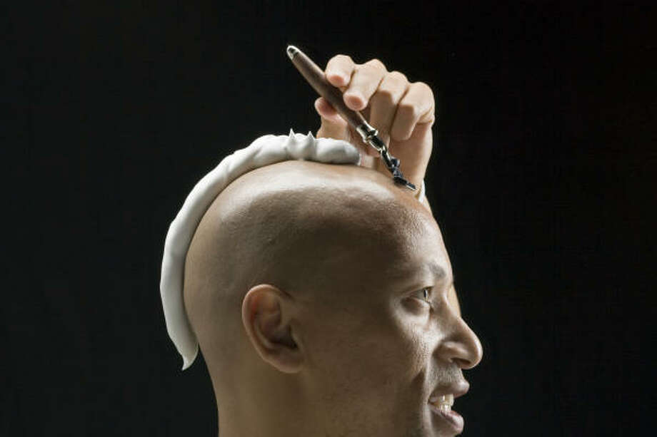 Model Curtis Brown of the Neal Hamil Agency lathers up and proceeds to shave his head, a look that has now gone mainstream. Photo: Buster Dean, Chronicle