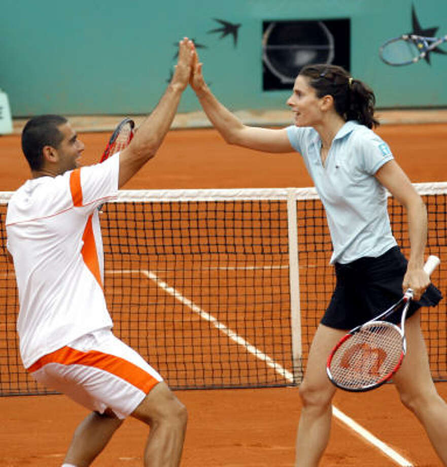 France's Nathalie Dechy, right, and Israel's Andy Ram defeated Slovenia's Katarina Srebotnik and Serbia's Nenad Zimonjic for the mixed doubles title at Roland Garros. Photo: DAVID VINCENT, AP