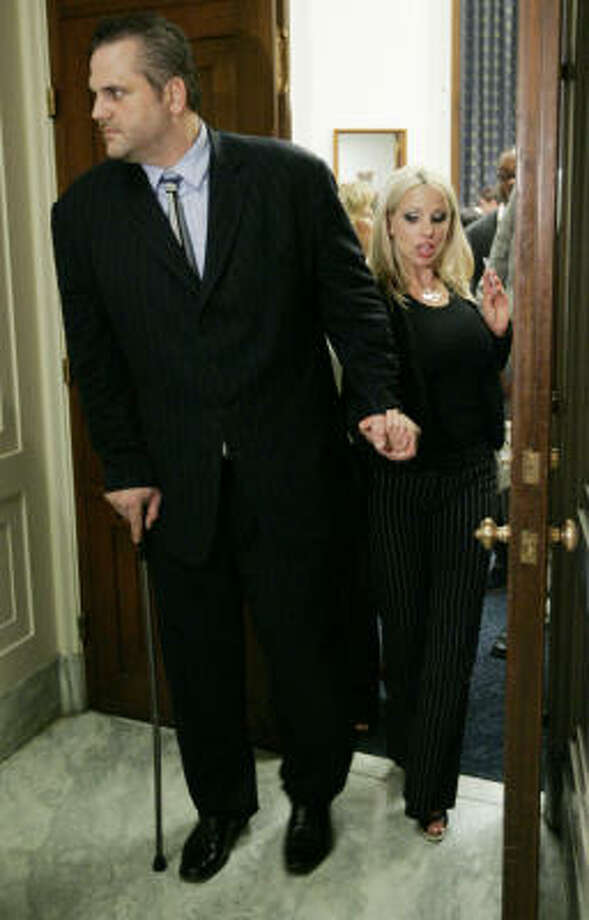 Using a cane, former Jacksonville Jaguars offensive lineman Brian DeMarco is helped by his wife Autumn as they leave the House Judiciary subcommittee hearing on the NFL's system for compensating retired and disabled players. Photo: Pablo Martinez Monsivais, AP