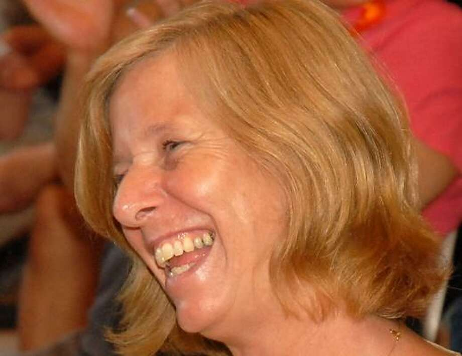 Cindy Sheehan thanks supporters in Houston for wishing her a happy birthday Tuesday. Photo: DAVE ROSSMAN, FOR THE CHRONICLE