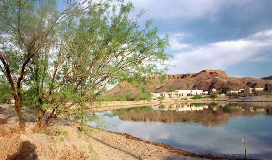 Condominiums rise near a pond at Lajitas Resort in April 2002. The getaway for the rich is in the Big Bend area. Photo: E. JOSEPH DEERING, CHRONICLE FILE