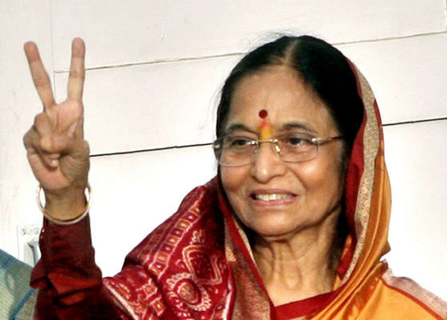 Newly elected Indian President Pratibha Patil, 72, gestures after the formal announcement of her victory in New Delhi, India, Saturday. Photo: Manish Swarup, AP