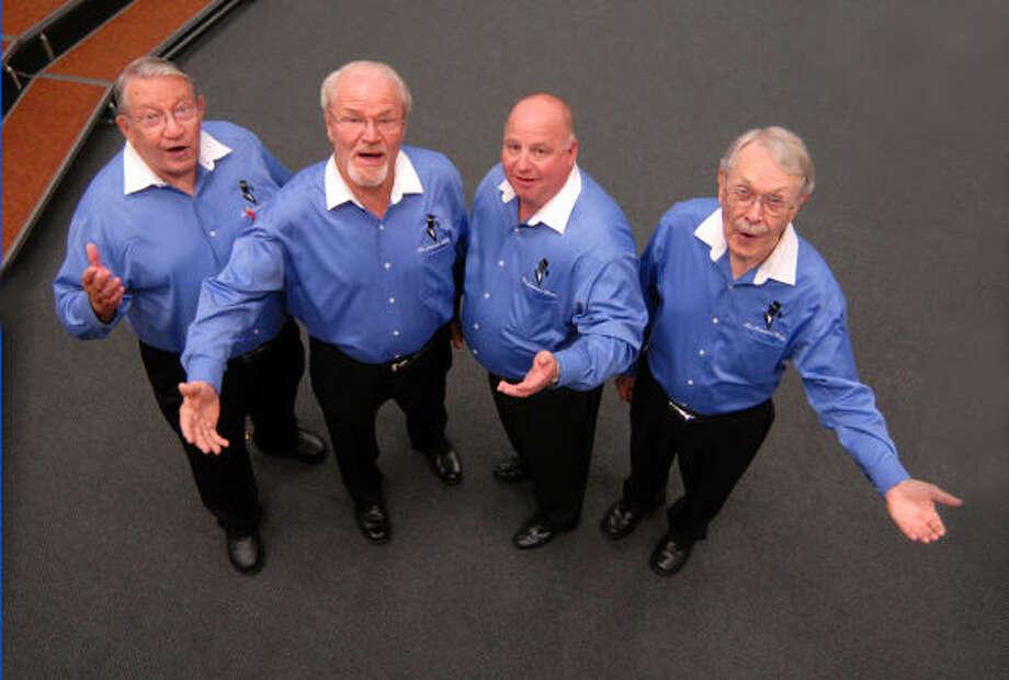 Statesmen Chorus members Jim Hoge, left, Don Cadwell, Joe Carson and Paul Wiegmann rehearse for an upcoming performance. Photo:  Brad Perkins, For The Chronicle