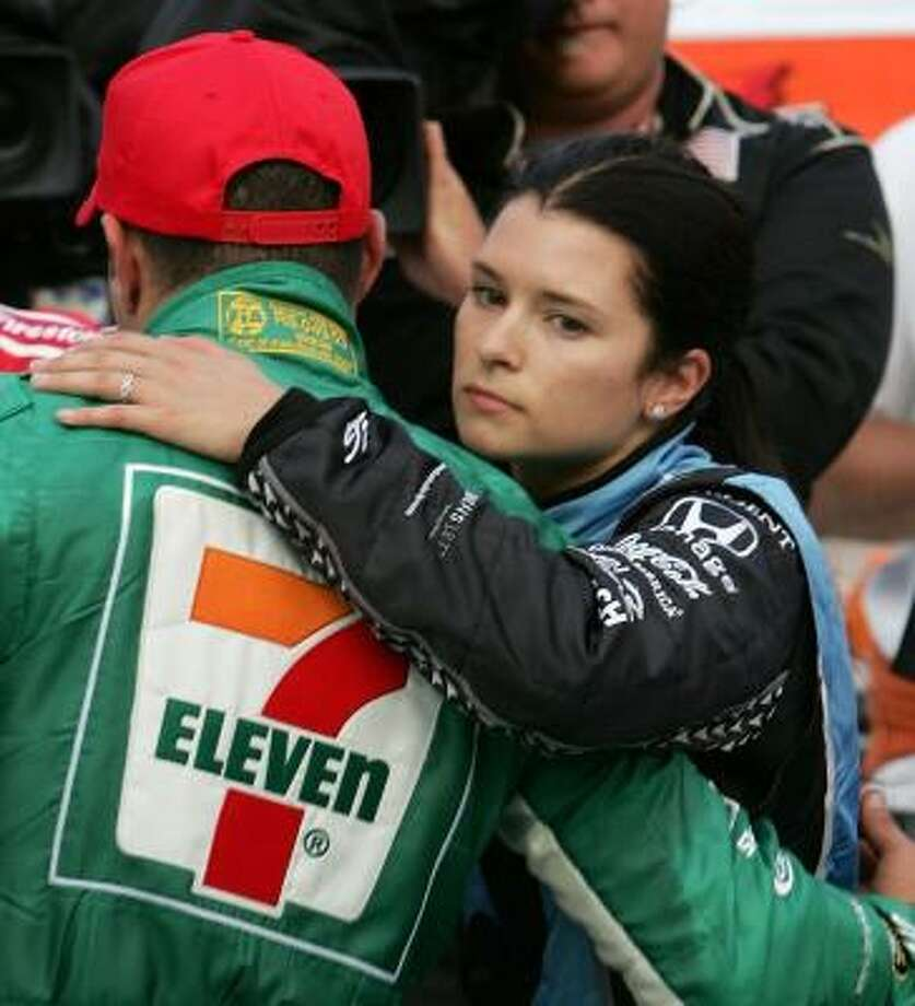 Winner Tony Kanaan and teammate Danica Patrick meet after the race. Only eight of 20 cars that started the 200-lap event were running at the end. Photo: Jonathan Ferrey, Getty Images