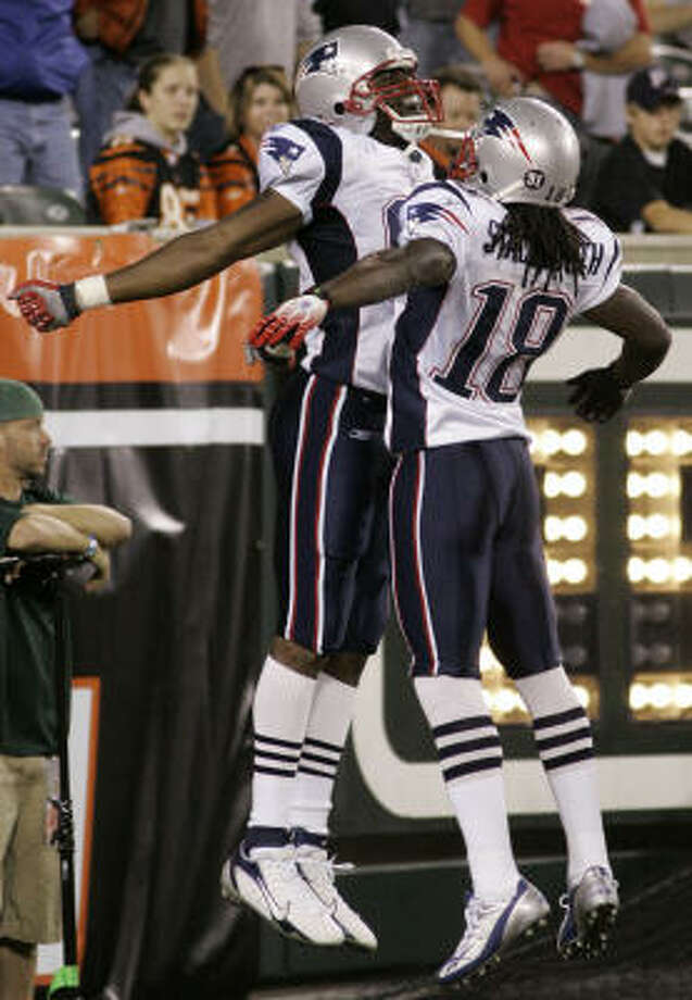 New England Patriots receiver Randy Moss bumps chests with Donte Stallworth (18) after Moss caught a touchdown pass from quarterback Tom Brady in the fourth quarter . Photo: Al Behrman, AP
