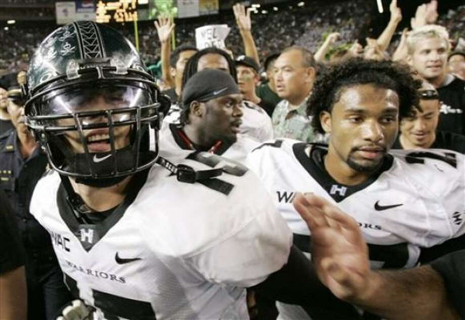 Hawaii should be happy with what it got, considering how weak its schedule was. Photo: HUGH GENTRY, AP
