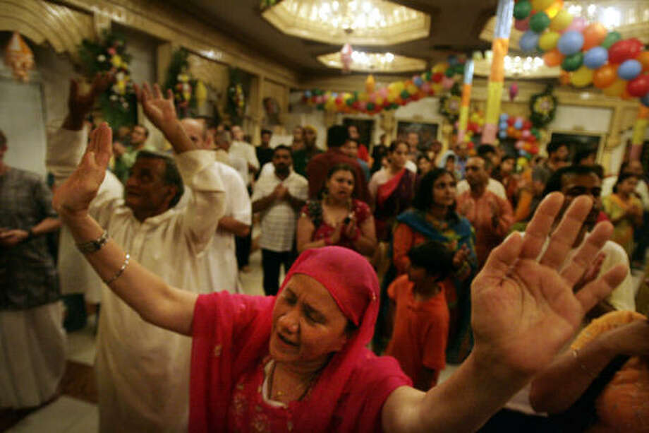 Aloka, cener, prays during the celebration of Janmashtami, recognizing the birth of Lord Krishna, on Sunday at the Hare Krishna Temple in Houston. Photo: Eric Kayne, Chronicle