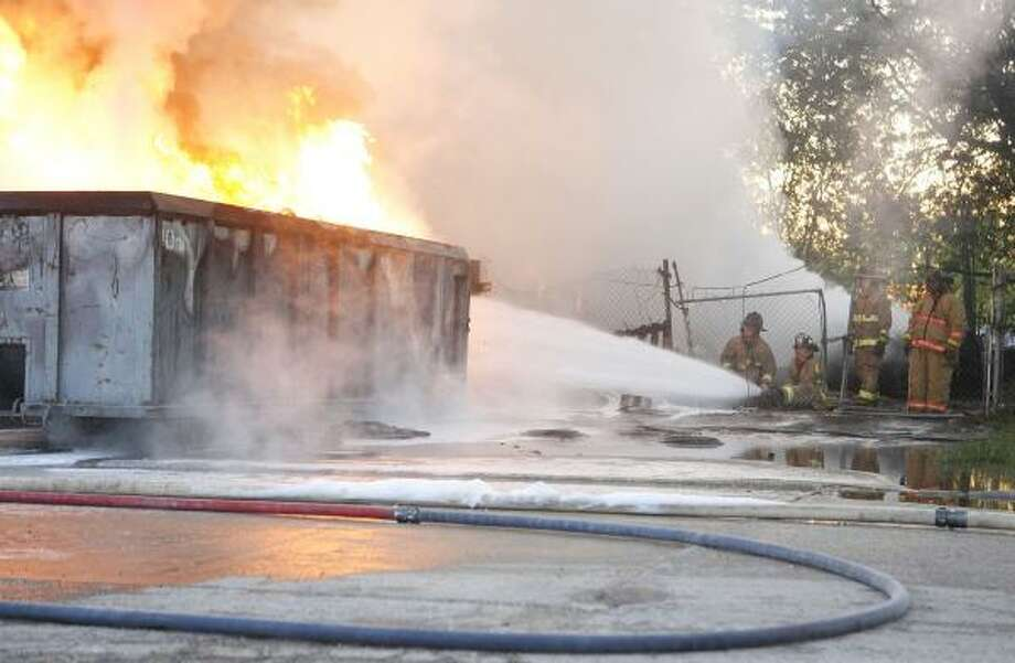 Firefighters battle a blaze at a used tire company off the Eastex Freeway at East Mount Houston road this morning. Photo: JAMES NIELSEN, Chronicle