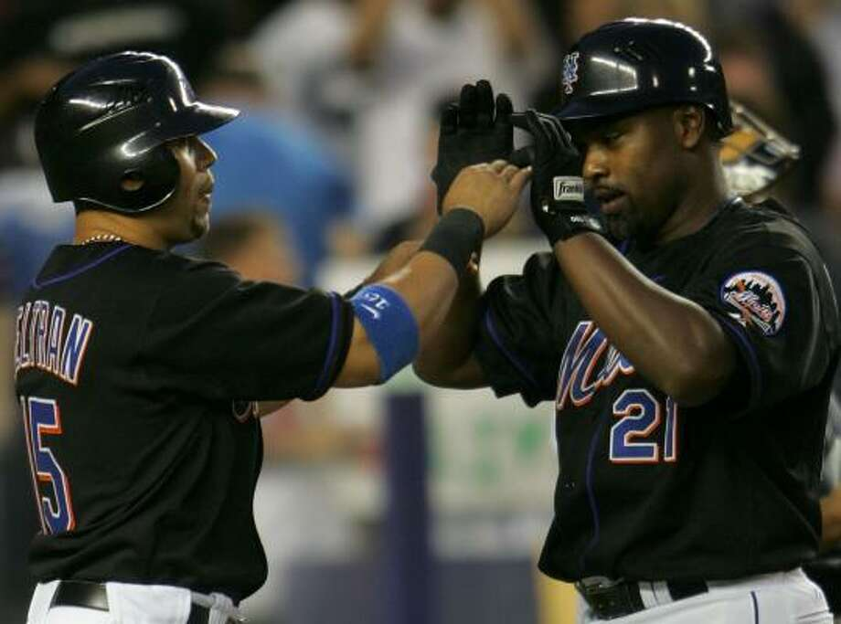 The Mets' Carlos Beltran greets Carlos Delgado after scoring on Delgado's two-run homer in the fourth inning. Photo: CHRIS McGRATH, AFP/GETTY IMAGES