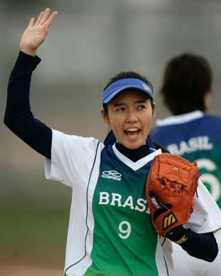 Brazil's Camila Ariki waves to the crowd during a game against Colombia at in the Pan American Games. Sixteen of the 17 players on the Brazilian softball team come from a community of Japanese immigrants. Photo: VICTOR R. CAIVANO, ASSOCIATED PRESS