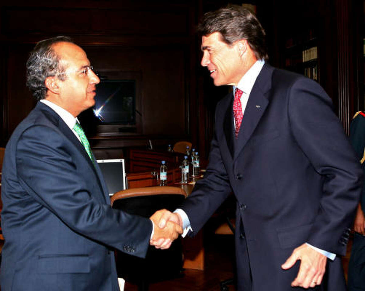 Perry, shown greeting Calderon, brought about 150 Texas business executives — including many from Houston — to Mexico looking for new deals in energy and other industries.