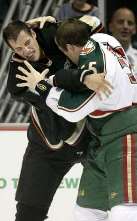The Ducks' Ryan Getzlaf, left, and the Wild's Nick Schultz square off. Photo: MARK AVERY, AP