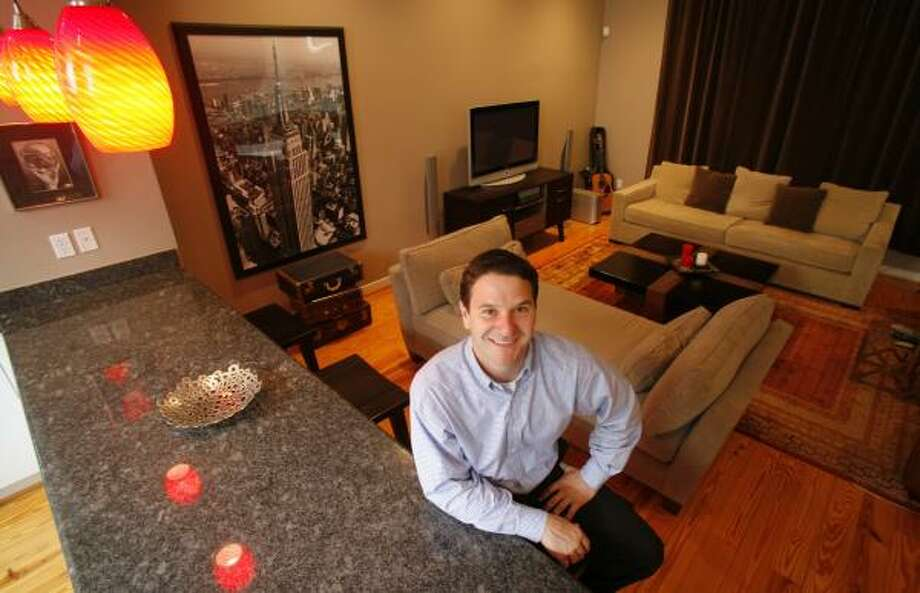 Josh Lowrey may move up his plans to sell his townhouse in the Sixth Ward because he's worried the Houston market may cool too much. Photo: STEVE UECKERT, CHRONICLE