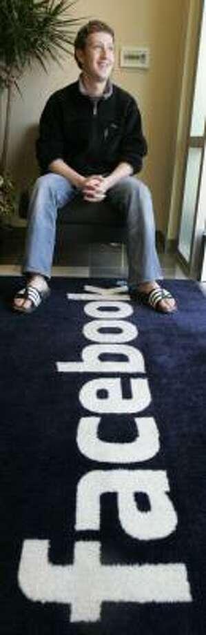 Facebook founder Mark Zuckerberg's company is now worth about $15 billion. Photo: PAUL SAKUMA, ASSOCIATED PRESS FILE