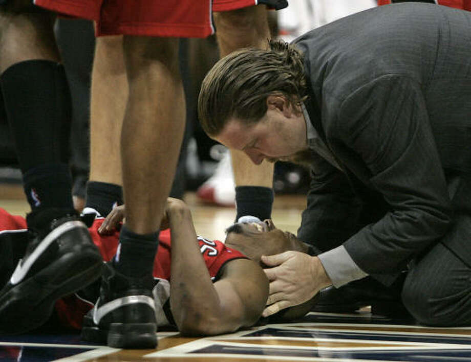 Raptors guard and Willowridge High School product T.J. Ford was taken off the court on a stretcher Tuesday after a hard foul by Atlanta's Al Horford. Photo: John Bazemore, AP