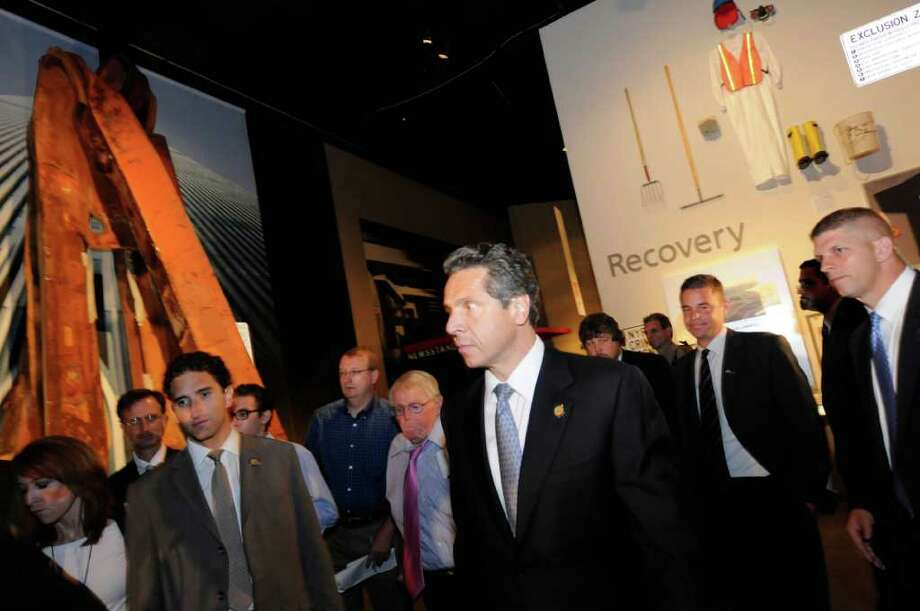 "Gov. Andrew Cuomo tours the State Museum's 9/11 exhibit on Wednesday in Albany during an announcement of 30 locations across the state for ""New York Remembers"" memorial exhibitions.( Michael P. Farrell/Times Union) Photo: Michael P. Farrell"