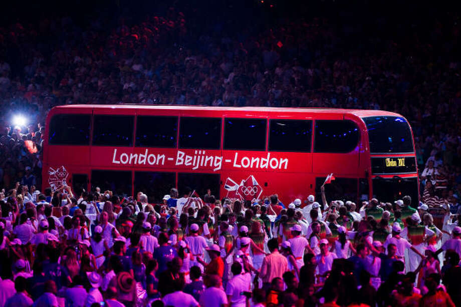 A double-decker bus enters the stadium for the London handover performance during closing ceremonies for the 2008 Summer Olympic Games. Photo: Smiley N. Pool, Chronicle