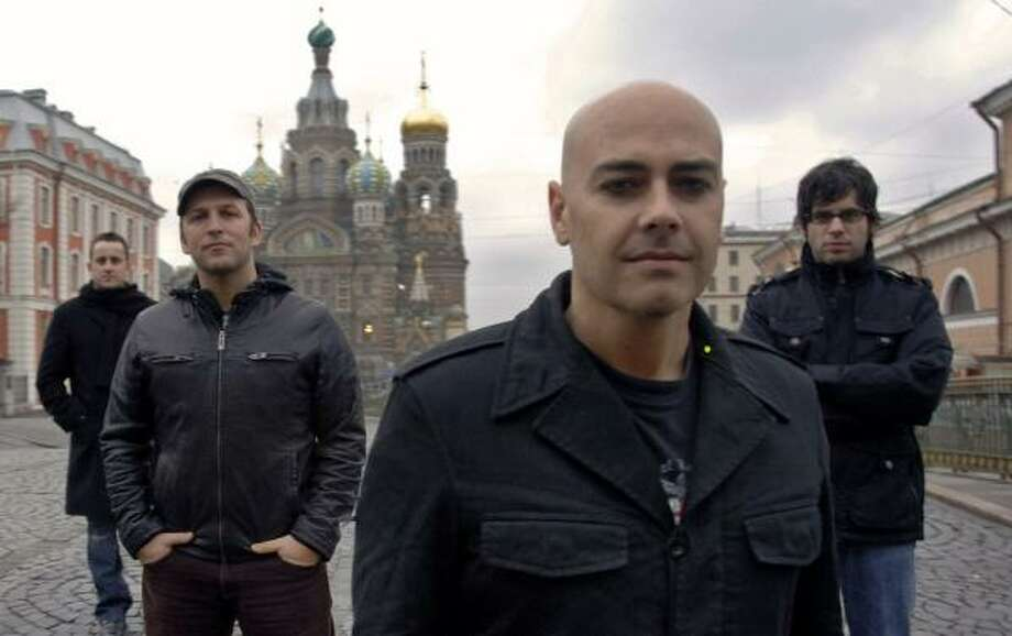 The newsboys will perform Friday in The Woodlands. At a church in St. Petersburg, Russia, are Duncan Phillips, from left, Paul Colman, Peter Furler and Jeff Frankenstein. Photo: Courtesy Photo, INPOP RECORDS